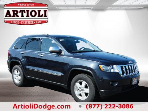 PRE-OWNED 2013 JEEP GRAND CHEROKEE LAREDO FOUR WHEEL DRIVE